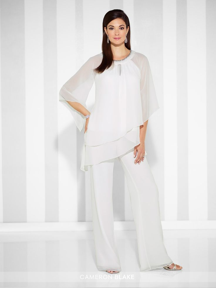 Cameron Blake - 117625 - Three-piece chiffon set, asymmetrically layered top features three-quarter length draped sleeves trimmed with hand-beading and a beaded round neckline with keyhole, ballerina-length A-line skirt with elastic waistband, flared leg pants with elastic waistband.Sizes: 4 – 20, 16W – 26WColors: Navy Blue,Ivory, Black