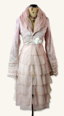 Dusty Mauve Tea Jacket    Ballet-chic. Dainty tiers of antique pink tulle and lace ruffles are flattered by hand-turned rosettes and embroidery. Tea length. 50% viscose, 50% nylon with 100% cotton lining.