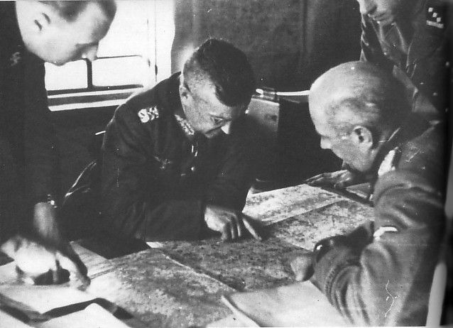 """Generaloberst Walter Model along with the SS-Kavallerie-Division """"Florian Geyer"""" which is under the command of 9.Armee (November 1942 s / d in February 1943). Here we can see the SS-Hauptsturmführer Baldur Keller (He """"Florian Geyer"""", right) and the divisional commander SS-und Generalmajor Brigadeführer der Waffen-SS Wilhelm Bittrich (back to camera)"""
