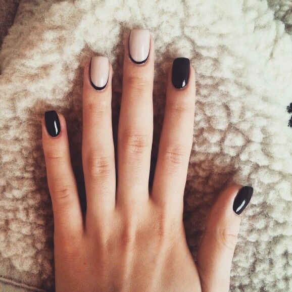 Black and beige reverse french manicure