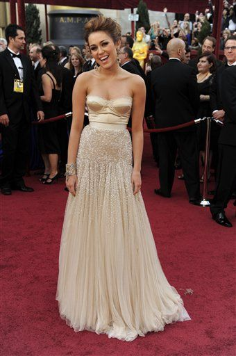 yeah i know, its miley cyrus but i really love this dress & she just needs to work on her posture. Love the hair too!