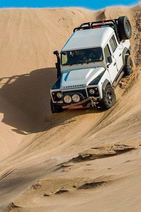 Land Rover Defender driving in desert sand - App for Land & Range Rovers warning lights and problems. https://itunes.apple.com/us/app/land-rover-indicators-warning
