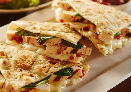 Grilled Chicken Piadina ~ thin Italian flatbread filled with tangy roasted red peppers, mushrooms, fresh spinach & savory Italian cheese sauce seasoned with garlic, basil & sun-dried tomatoes.