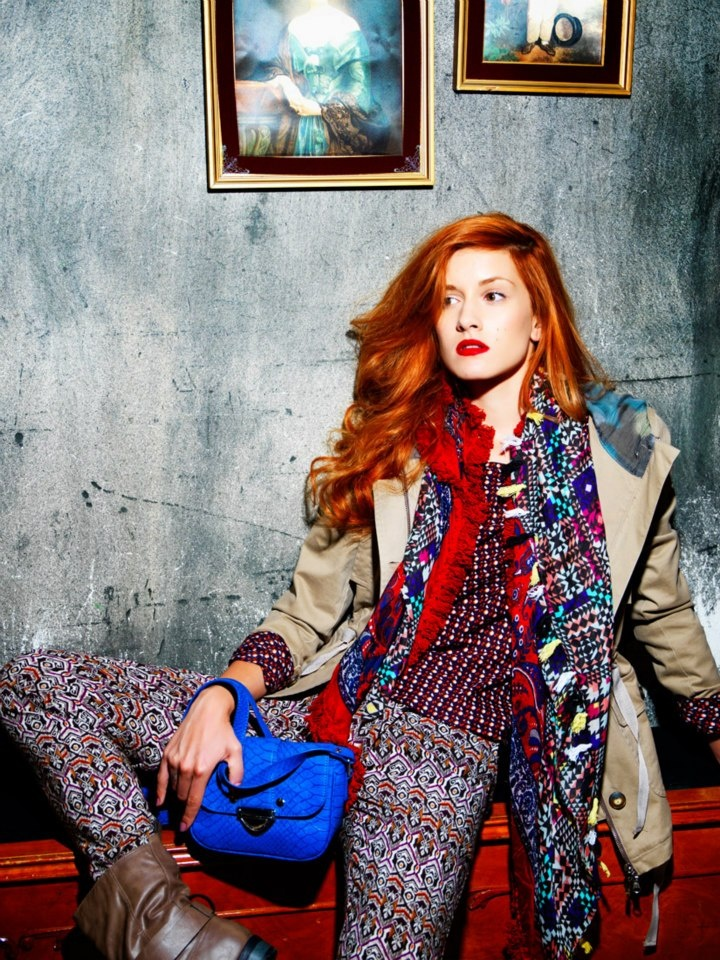 Beautiful pattern trouser, colorful scarf and beige coat.