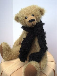 I am delighted to introduce Hughie, a traditional style teddy bear.  He is approximately 12inches (30cm) tall and is adorned with a hand knit black scarf.  $110.00