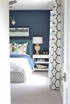 Gentleman's Gray by Benjamin Moore for the accent wall (the blue color) and Colonnade Gray by Sherwin Williams for the rest of the room.