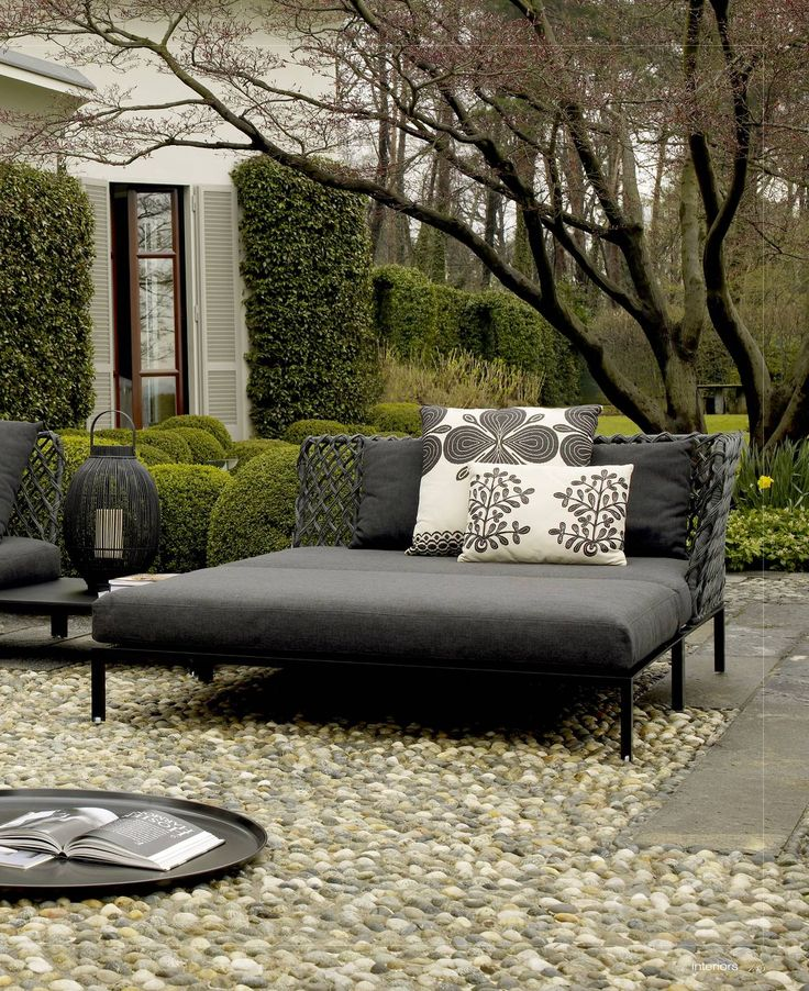 Outdoor Day Bed On Cobbled Patio.