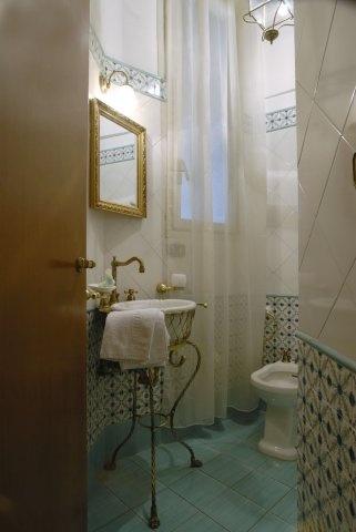 Old style bathroom. Love the mirror.