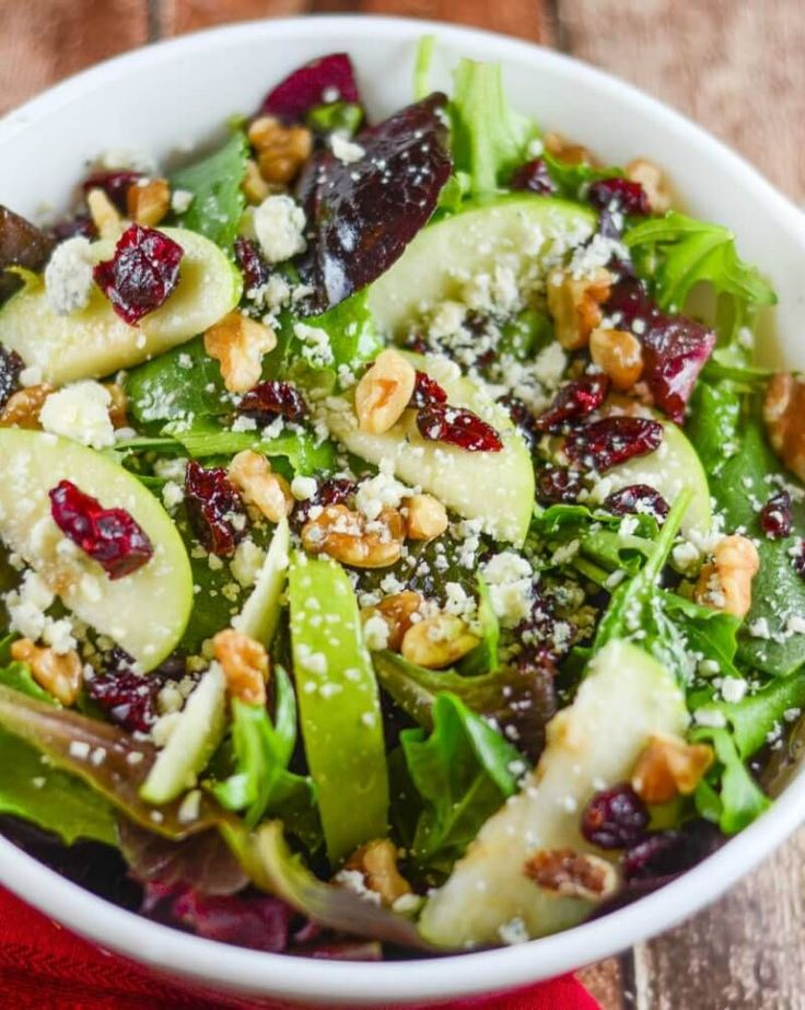 This Apple Walnut Cranberry Salad includes so many flavor-packed ingredients I can't fit them all into the recipe title. Let's try it and see. Mixed Green Spinach Salad with Green Apples, Dried Cranberries, Walnuts and Gorgonzola Cheese. Hmmmm. While extremely accurate, it is extremely long. Suffice it to say, your salad bowl will be filled...
