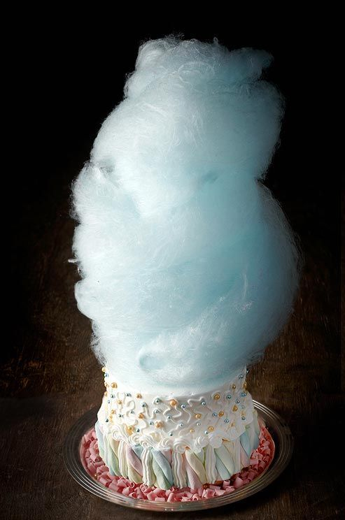 Volcano Cake.. A floating tuft of blue cotton candy gives this sweetly-decorated cake  dramatic height.