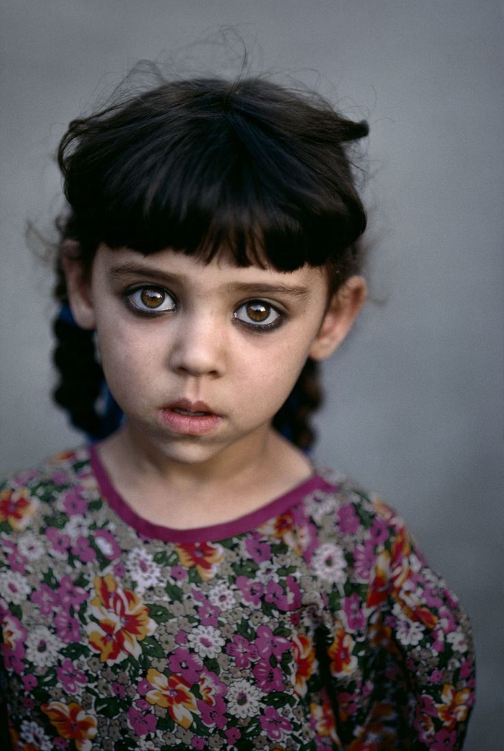 This little girl lived in an orphanage in Kandahar, Afghanistan.  Her eyes, ringed with kohl, speak volumes about her short life.