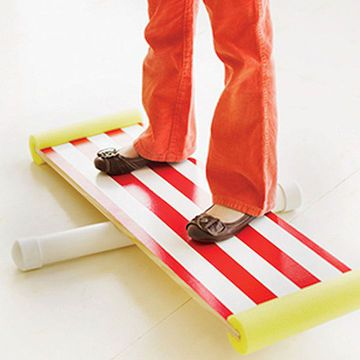 This simple device will thrill your little daredevils. Challenge kids to see who can stand on the board the longest without letting the ends touch the ground. Our directions give a couple of sizes for the board and for the pipe, so you can choose the degree of difficulty. (Balancing is easier on a wider board and pipe, harder on a narrower board and pipe.)                 You will need: Pencil and ruler Board, 10 or 12 inches wide and 36 inches long (many lumber yards will cut to this…