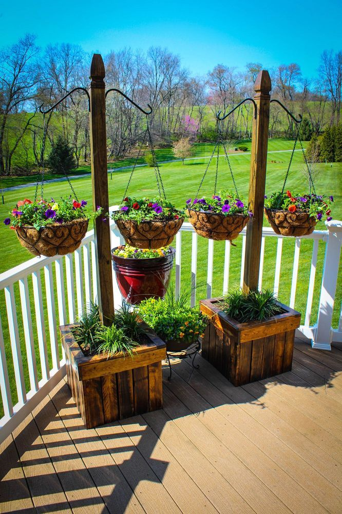 Garden Basket Ideas hanging baskets out of tin cans painted in striking colors perfect for growing annuals and herbs Hanging Basket Column