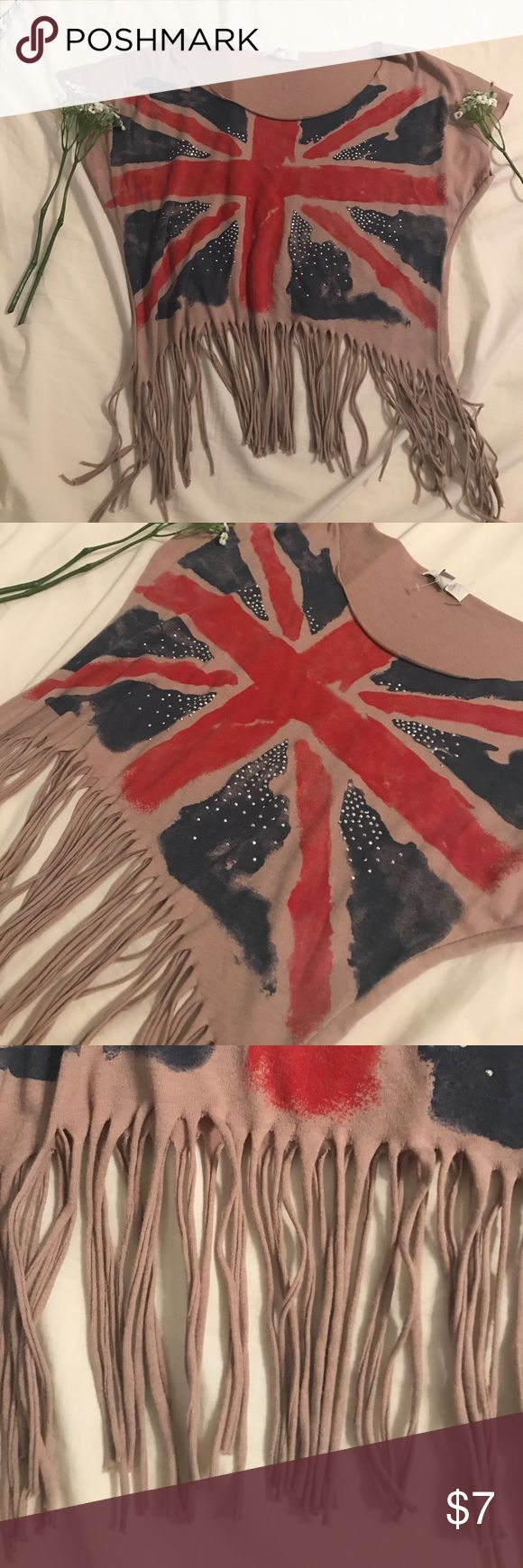 Union Jack Crop Top Tan Crop Top with Union Jack flag print on front! Also has some small rhinestone embellishments. Frays along bottom and scoop neck. Condition is like new! delia's Tops Crop Tops