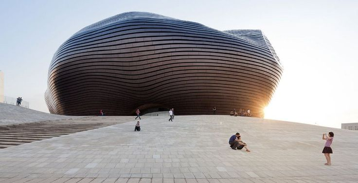 NEW ORDOS MUSEUM BY MAD ARCHITECTS Located in the new city center of Ordos, MAD Architects has built the Art & City museum, an amorphous building that looks as if it has landed on earth.  www.thefacedesign.com
