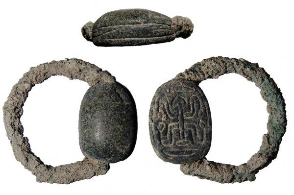 Egyptian scarab and bronze ring, Second Intermediate period, 1650-1549 B.C. Green-black steatite, on base 'sma-twy' symbol of the unification of the two lands, scarab 1.8 cm long. Private collection