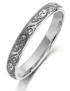 This seems to be the woman's version of this ring.  It's all most too busy in the thinner width.   Perhaps make it a little wider for me than is traditional.
