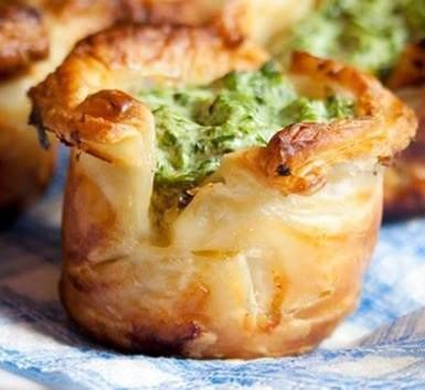 Puff Pastry Spinach Cups Ingredients: 1 Store bought Puff Pastry 10 oz Frozen Spinach 1 T. Sour Cream 3 T. Cream Cheese 3 garlic cloves 1 Cup Cheese, grated (your choice) Salt and Black Pepper to taste 2 tsp. oil