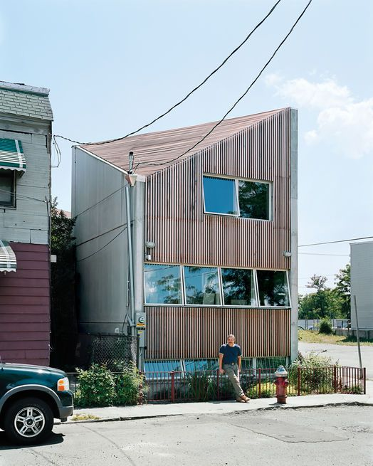 GRO Architects designed a welcoming open-plan house for Denis Carpenter, which they shoehorned into a tiny nonconforming lot among a block's worth of older row houses and a derelict public park.  Photo by: Samantha Contis