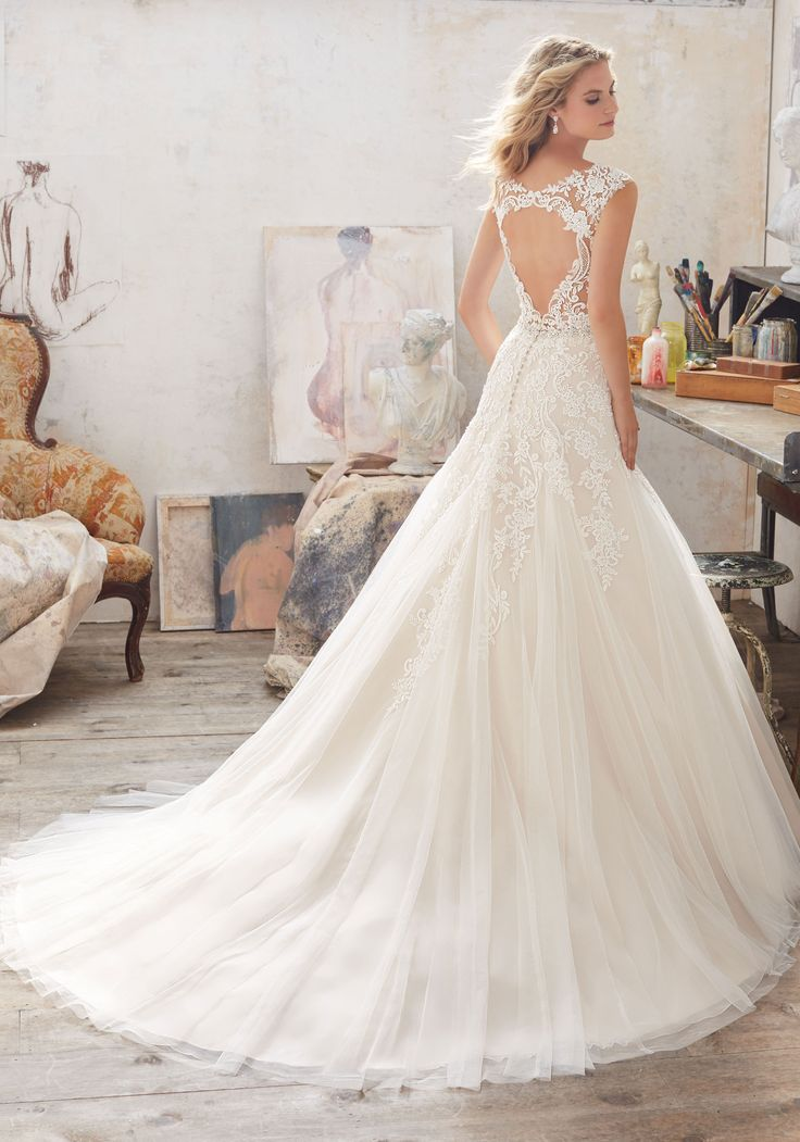 Morilee by Madeline Gardner 'Marciana' 8117 | This Fairytale Bridal Gown Features a Bodice of Crystal Beaded Alençon Lace AppliquéŽs on Soft Tulle. Delicately Beaded Waistline and Illusion Keyhole Back.
