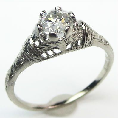 The Sylph: A slender silhouette and graceful detail define this classic, feminine filigree ring.  Ca. 1925.  Maloys.com