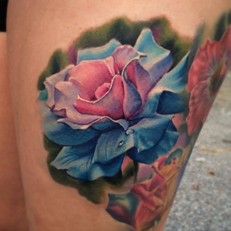 """""""We love rose tattoos, gorgeous piece by Artist @mikejohnstontattoo"""""""