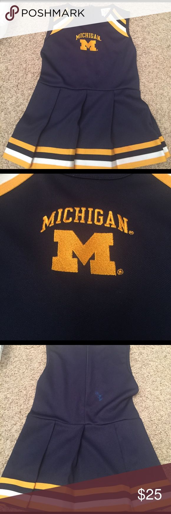 Michigan Munchkin Cheer Dress Girls size S/M. Dress has blue mark on back (see pic). Official Michigan gear for your super (mini) fans! Right in time for the big tourney! Go Big Blue! Dresses