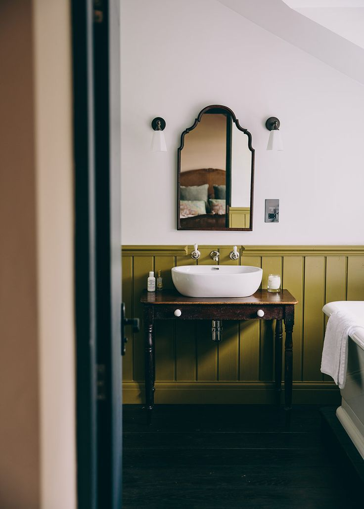 rich pear green wainscotting in the the bath | coco kelley