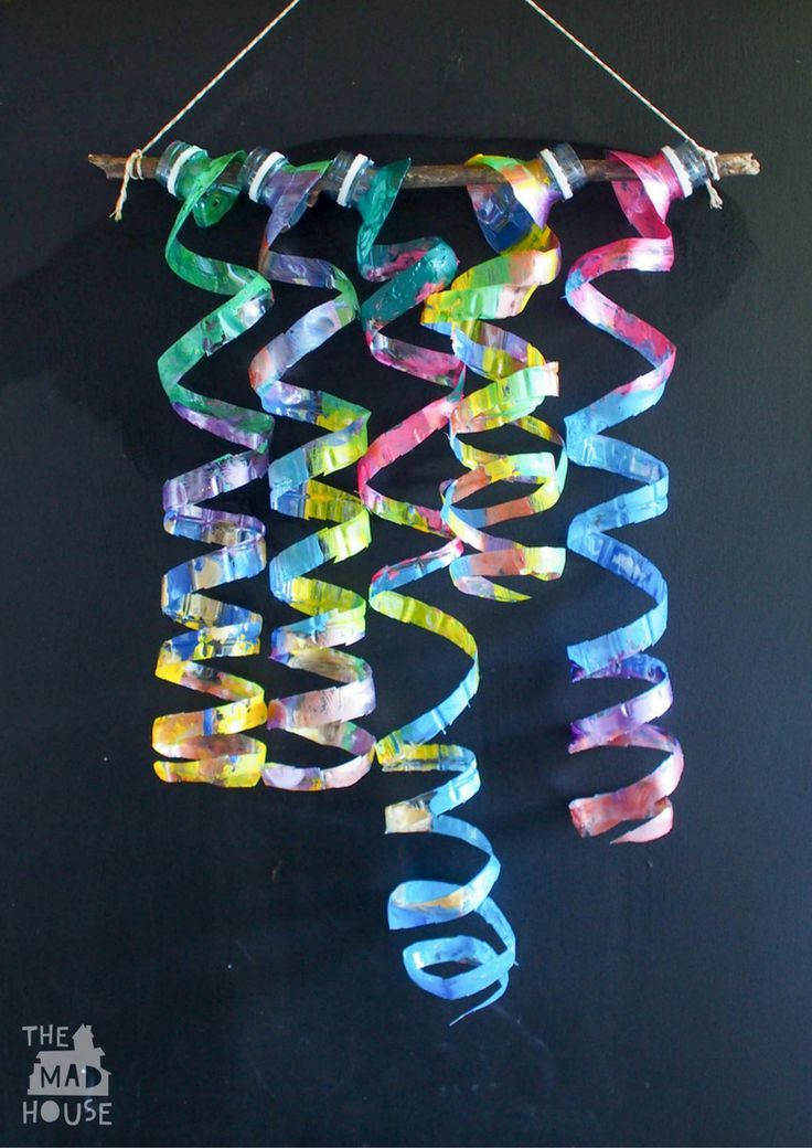 Upcycle plastic water bottles with this fantastic child-led process art activity to create a plastic bottle wind spiral mobile and plastic bottle sculpture.