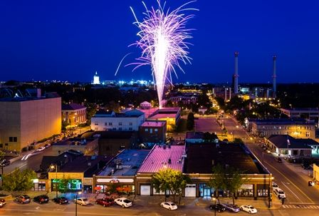 View of downtown Columbia, MO. Fireworks show during annual Fourth of July celebration.