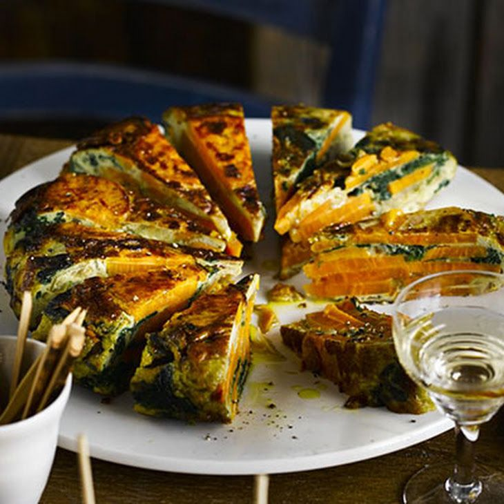 Spinach & Sweet Potato Tortilla Recipe Lunch and Snacks with baby spinach leaves, mild olive oil, onions, sweet potatoes, garlic cloves, large eggs