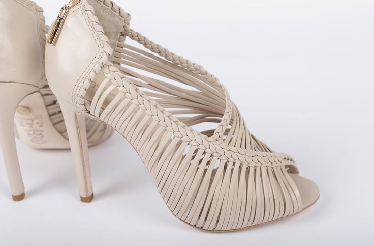 Hot nude strappy heels make any day better.   These Guilhermina Tatienne leather heels will give you a reason to get out of bed in the morning.  Designed for all seasons and any occasion, they're an essential to every closet.  One thing we tell you, be ready to turn up the heat in these fiery stilettos.