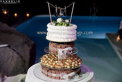 Chocolate Santorini Wedding Cake by Petran Art Pastry Chef ! I Wedding Event Planner Poema Weddings & Special Events I Flower Design by Wedding Wish I Catering Services by Spicy Bites I Photography by Vangelis Photography I Wedding Venue Aenaon Villas