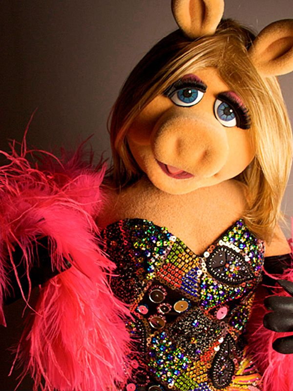 Miss Piggy wearing a Julien MacDonald dress. -  Express your feelings all the time unless you are trying to hide something.