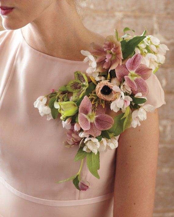 """For a surprising alternative to attendant bouquets, Merrick looks to the past, reinventing the classic corsage as an oversize accessory. """"It's reminiscent of the 1950s but feels fresh when made a bit larger,"""" she says. Pin one on your maid of honor to help her stand out (and keep her hands free for dress-fluffing). And aim high: """"The key is to put all the weight on the shoulder,"""" says Merrick."""