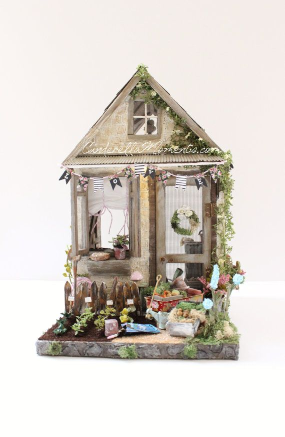 This garden shed dollhouse is a custom piece, handmade, signed. It has 2 battery operated lights and comes with all the furniture and