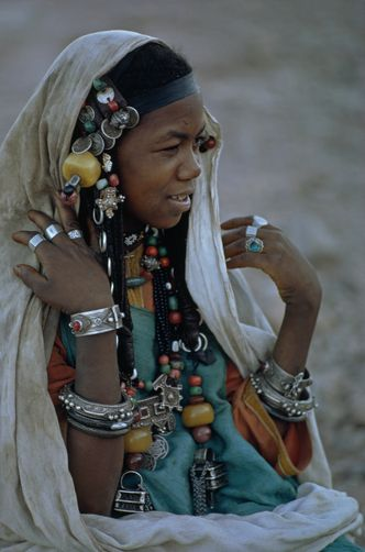 nostalgerie: A Berber woman wears her prized silver jewelry at a friend's wedding. Akka, Morocco