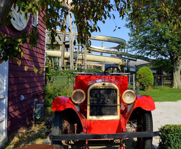 Beautifully restored old fire engine with water slide in the background: Geneva-on-the-Lake, Ohio