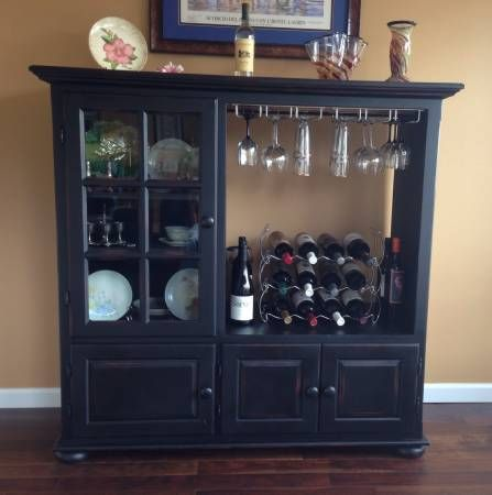 $200 OBO Cabinet was originally a TV cabinet for the old style box TV and additional equipment (VCR, DVD, etc.). I converted it into a wine and glass storage unit which worked really well and looked...