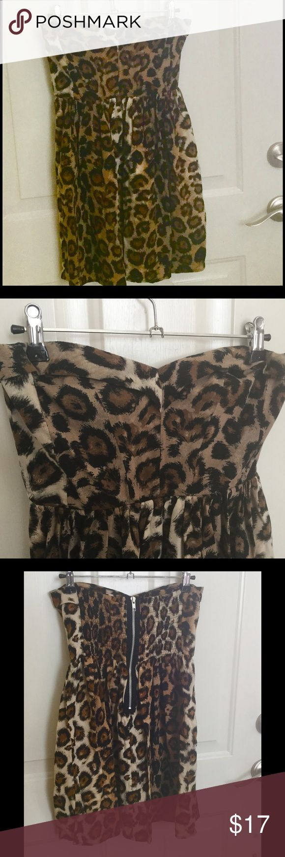 "Moda Cheetah Leopard Mini Dress Strapless Sexy 6 Cute, strapless dress with exposed zipper in the back. Gathered elastic in back to help with fit. Approximate measurements are chest 28"", waist 26"" and length 23"". Moda International, size 6, 100% rayon. No holes or stains. Thanks for looking ❤ Moda International Dresses Strapless"