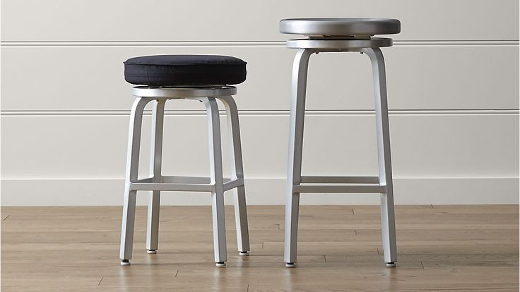 Shop Spin Swivel Backless Bar Stools and Cushion.   Spin offers functional counter convenience with an industrial look for an everyday value.  For added comfort, cap the stool with an elastic-fitted seat cushion that stretches for a custom fit.