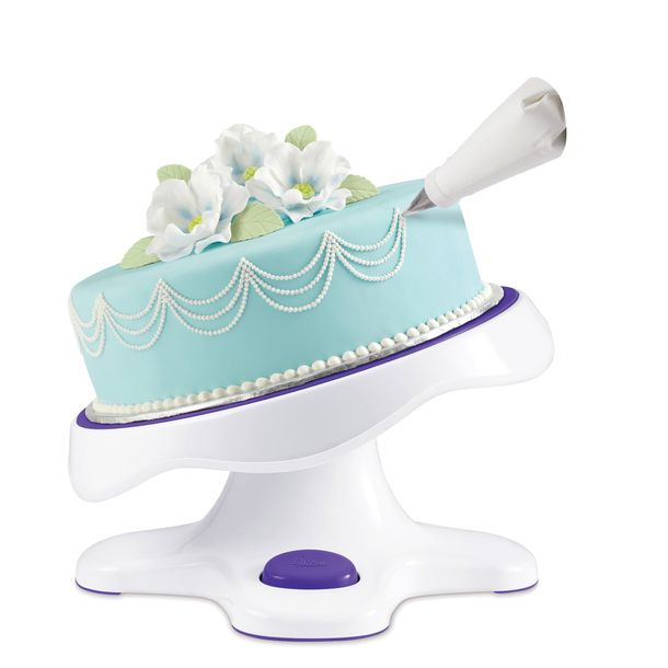 Tilt N Turn Cake Turntable angles and rotates, allowing for effortless, comfortable decorating.