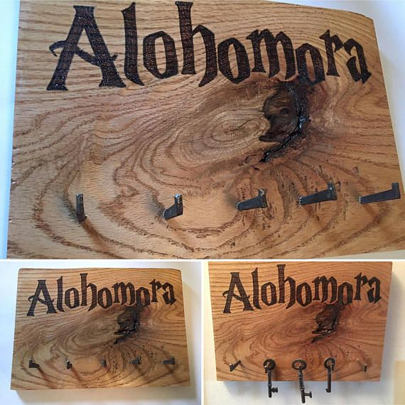 Alohomora key tidy key hooks on rustic oak board.