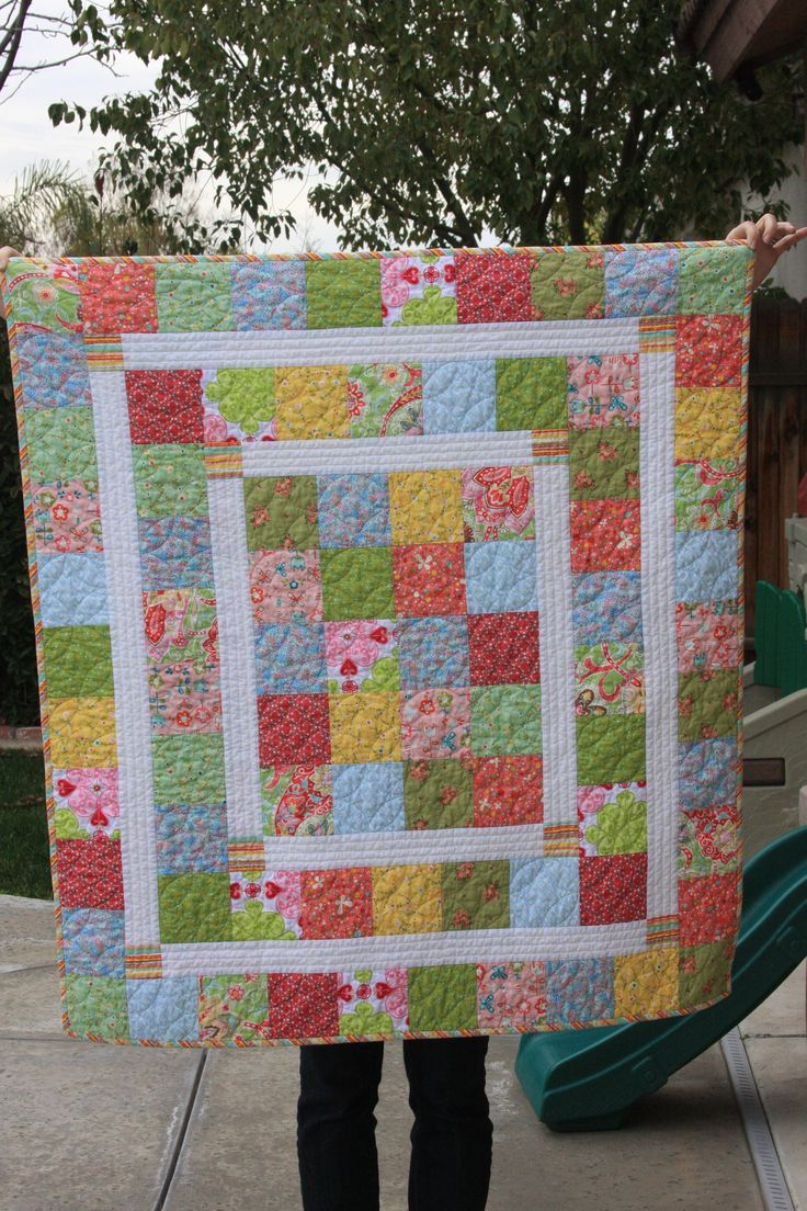 The Kelsie Baby Quilt from Rebel Perfection. Like the inner borders. Makes the quilt more interesting than just all blocks. Nicely done.
