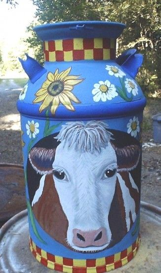 hand painted milk cans - cute design... I might need to paint one of mine...