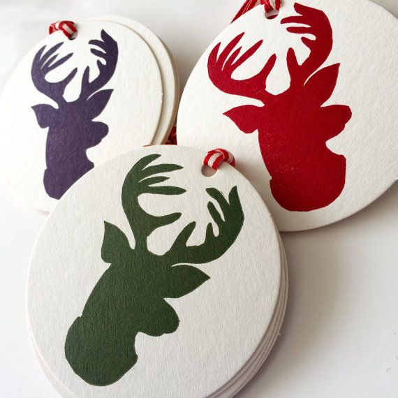 Classy Christmas reindeer to pretty up all your gifts or can be used as tree decorations letterpress printed on lovely super thick squishy coaster card printed from an original hand carved lino block then printed on my table top adana letterpress machine      the tags are all 90mm in Diameter, the standard drink coaster size which makes them ideal for either gift tags or decorations.  each tag has a red and white ribbon tie    your tags with be package together in a resealable cello bag then…