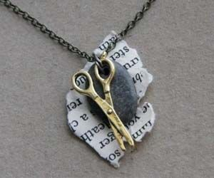 Combine all the elements of strategy into one cute necklace with the rock paper scissors necklace. These hand made necklaces are crafted using a gold plated scissor charm, a torn piece of a novel's page, and a small rock found from the shore of Lake Michigan.