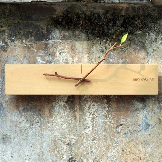 A clock designed to remind you of the simplicity found within nature, this DIY Bud Clock is the perfect interior piece for collectors of imaginative design pieces.