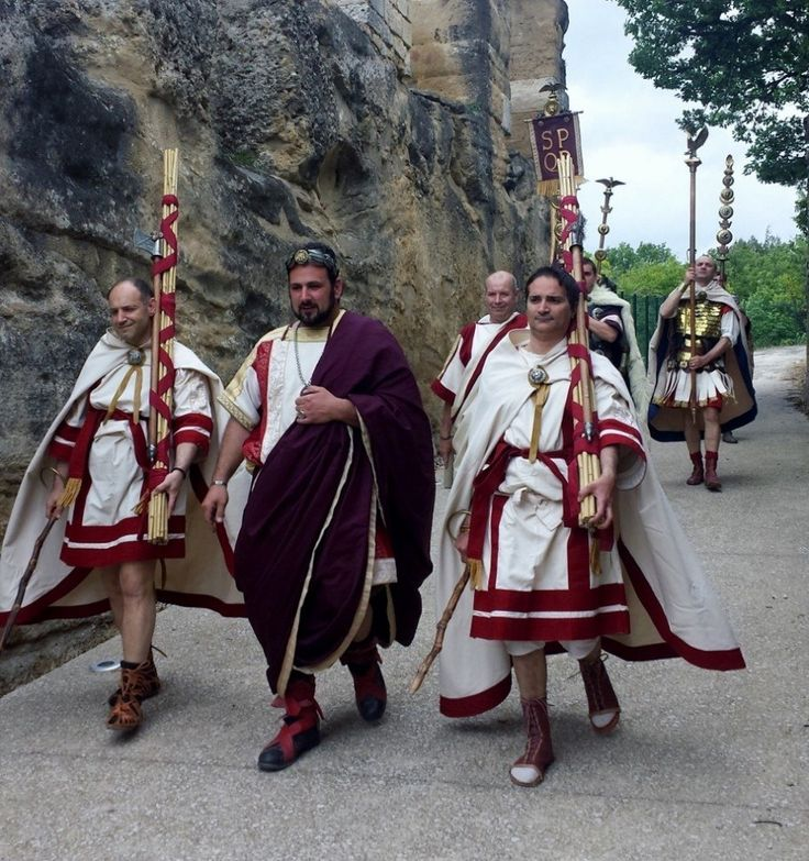 A Roman consul is flanked by Lictors carrying the fasces - the symbol of authority.