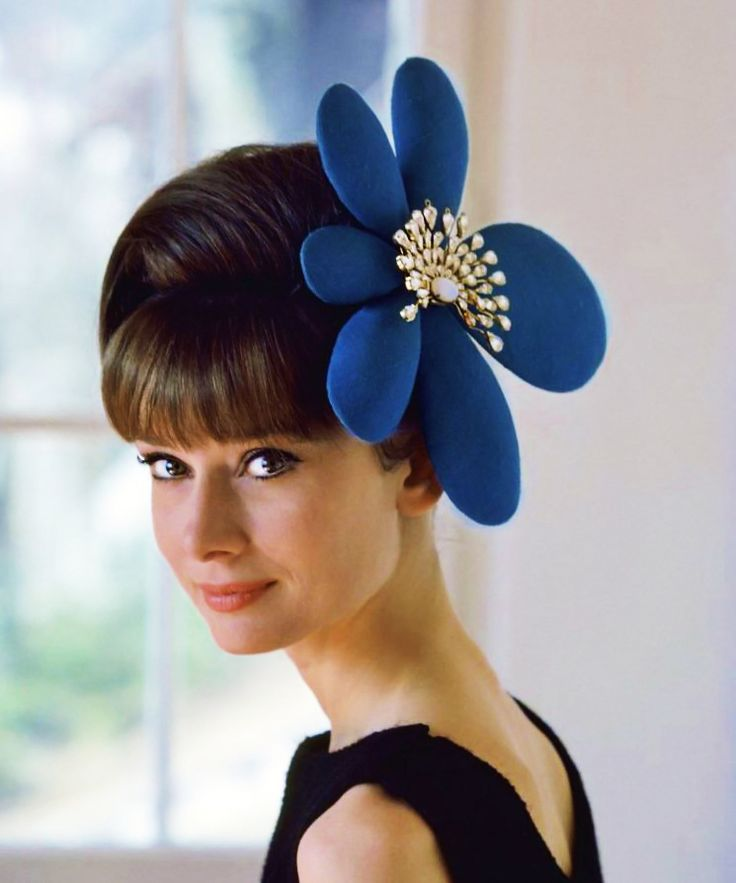 Audrey Hepburn photographed by Howell Conant at her home in Switzerland for a fashion editorial, Feb 1962.  Ms. Hepburn's hat and dress were made specially for her by fashion designer and friend, Hubert de Givenchy.